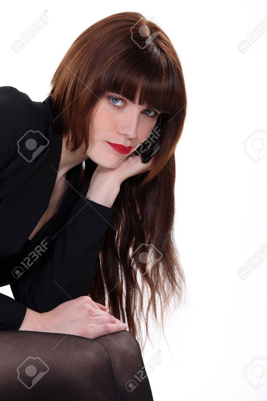 Enticing woman with long hair Stock Photo - 13458002