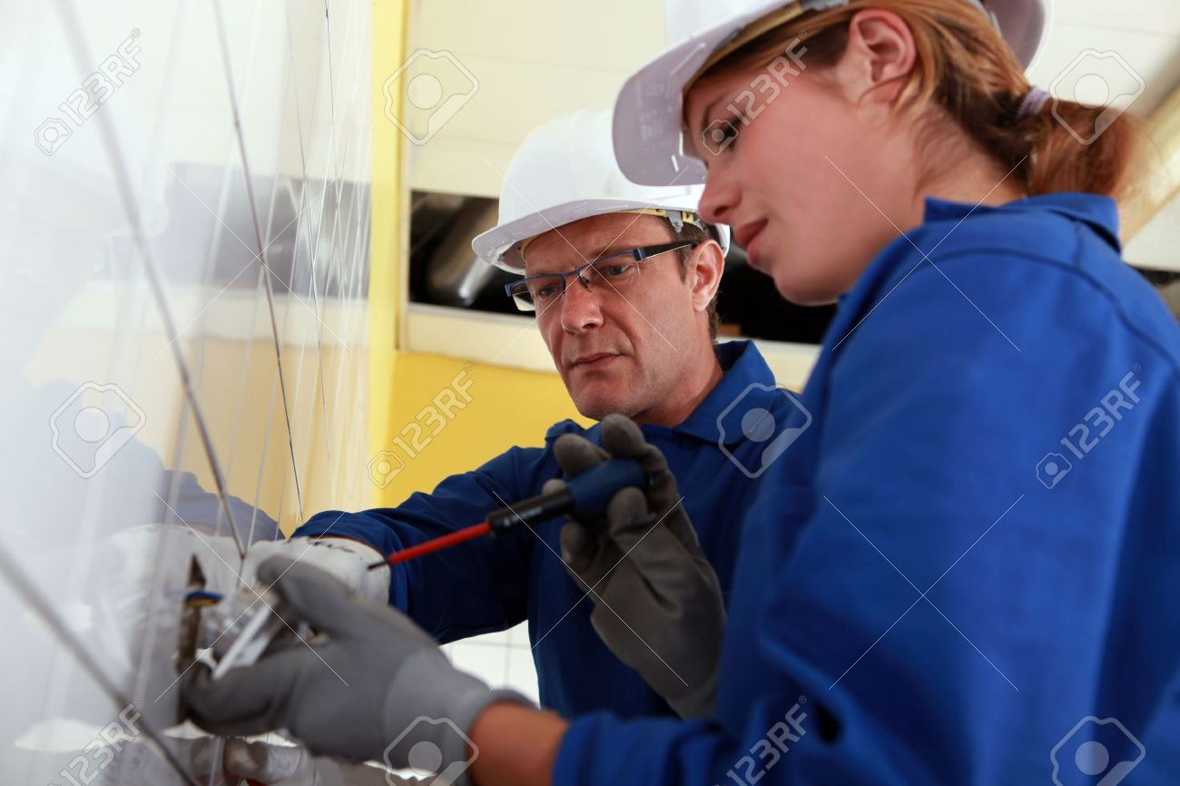 Electrician and his apprentice Stock Photo - 13541949
