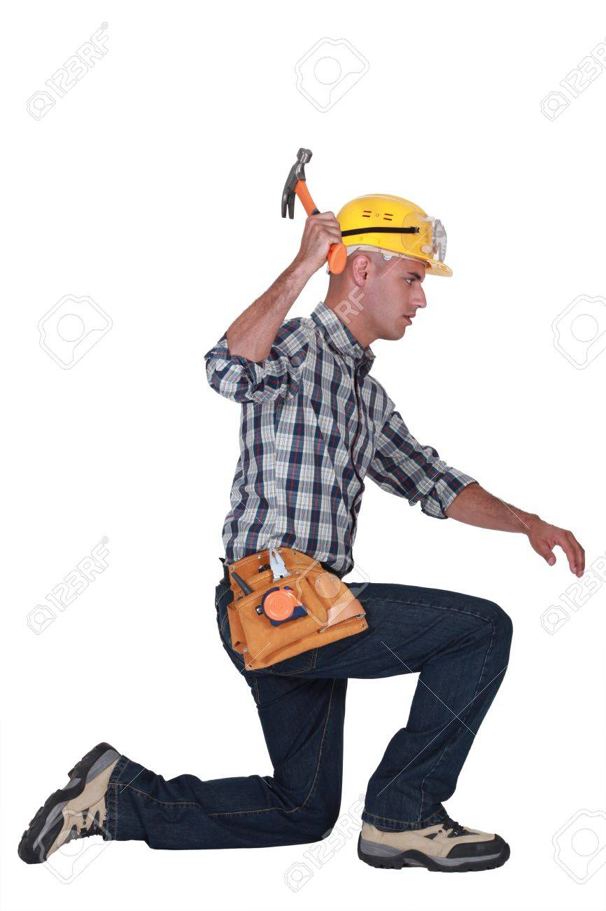 carpenter in profile using hammer Stock Photo - 13541335
