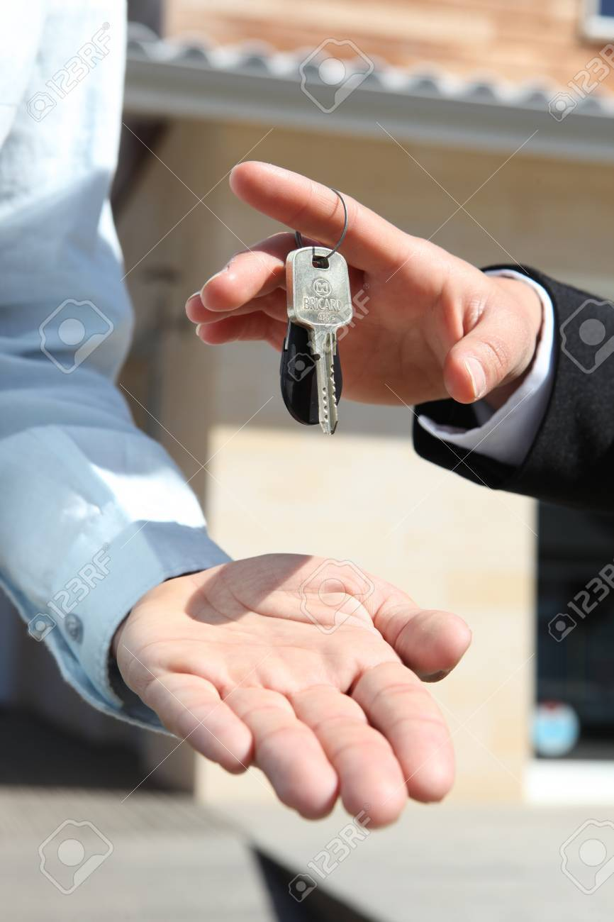 Agent handing over house keys Stock Photo - 13560754