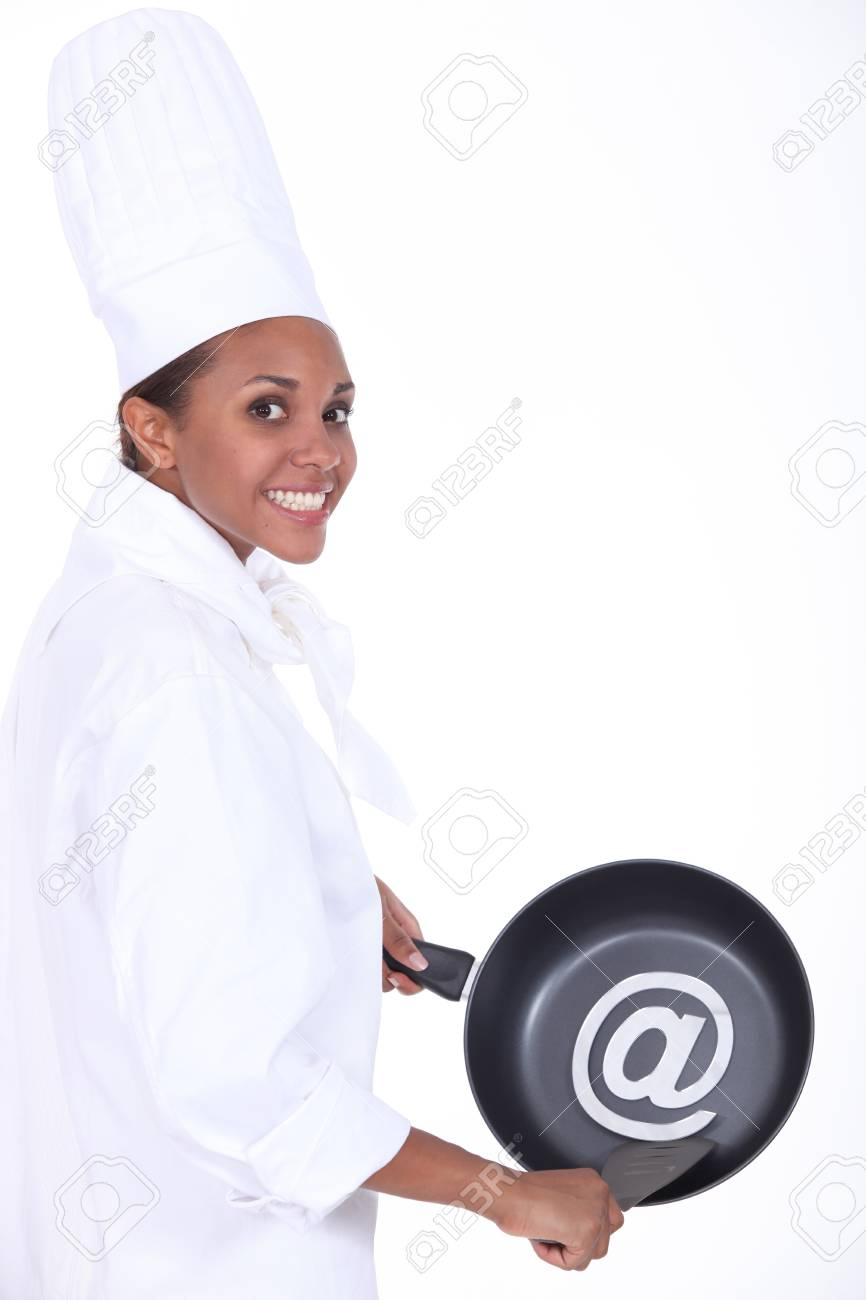 Chef Holding Frying Pan With At Symbol Stock Photo Picture And