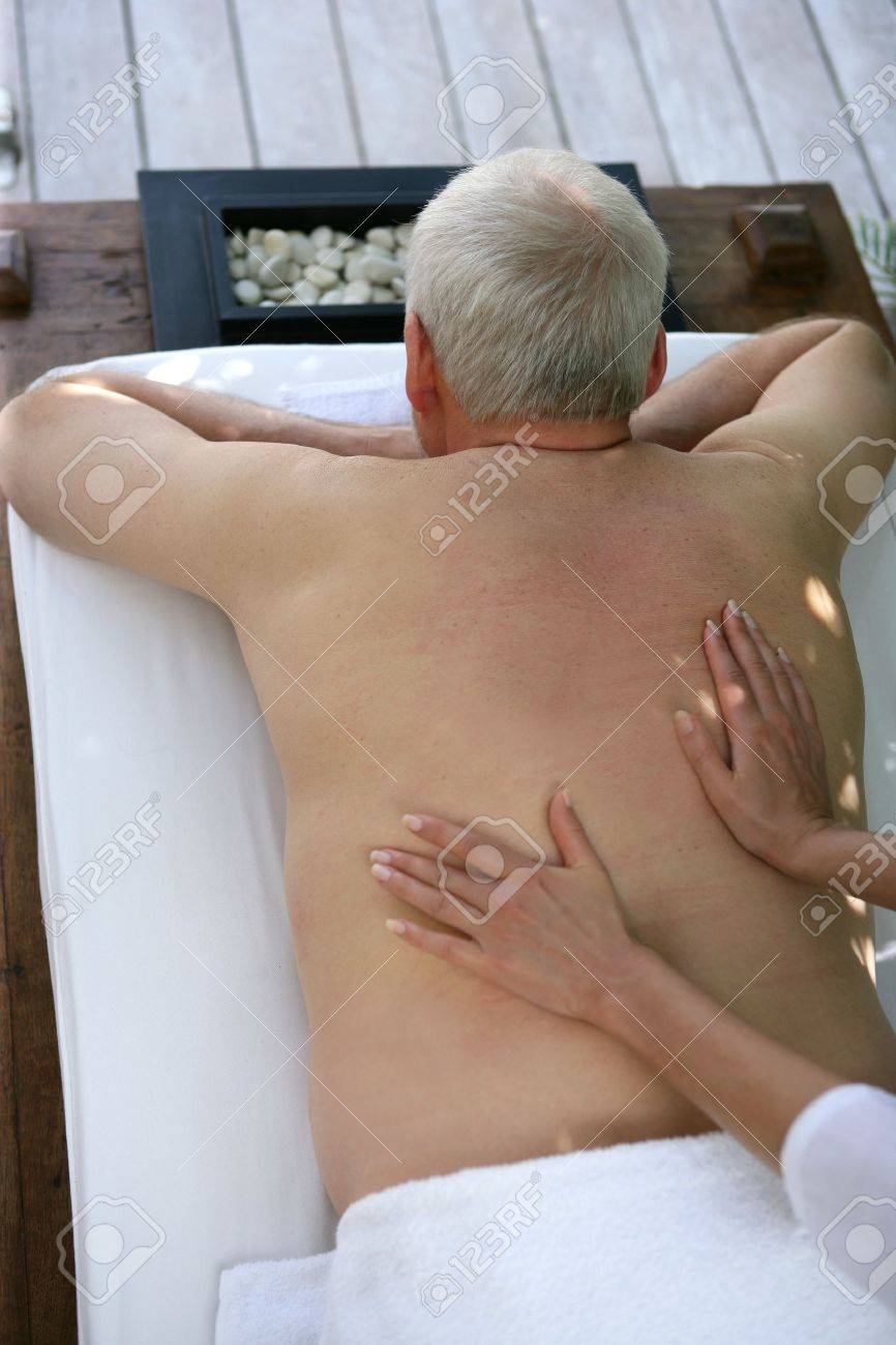 Senior man receiving a back massage Stock Photo - 13583143