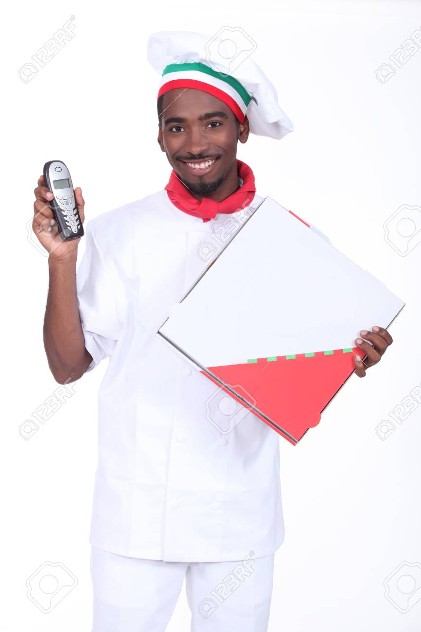 Chef with a telephone and a take away pizza box Stock Photo - 13583449
