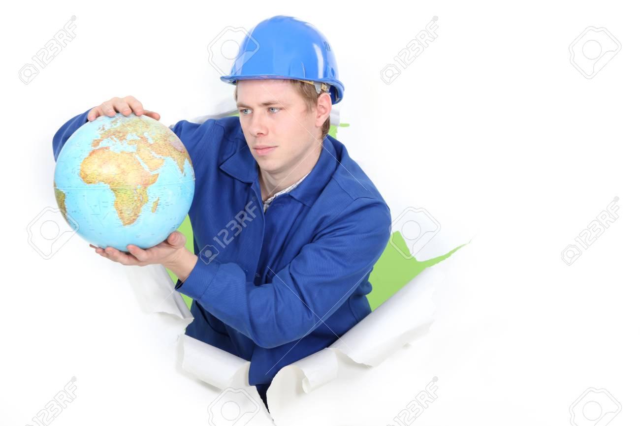 Tradesman holding a globe Stock Photo - 13583743