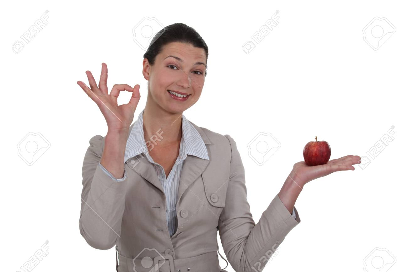 Woman holding an apple and giving the OK sign Stock Photo - 13584002