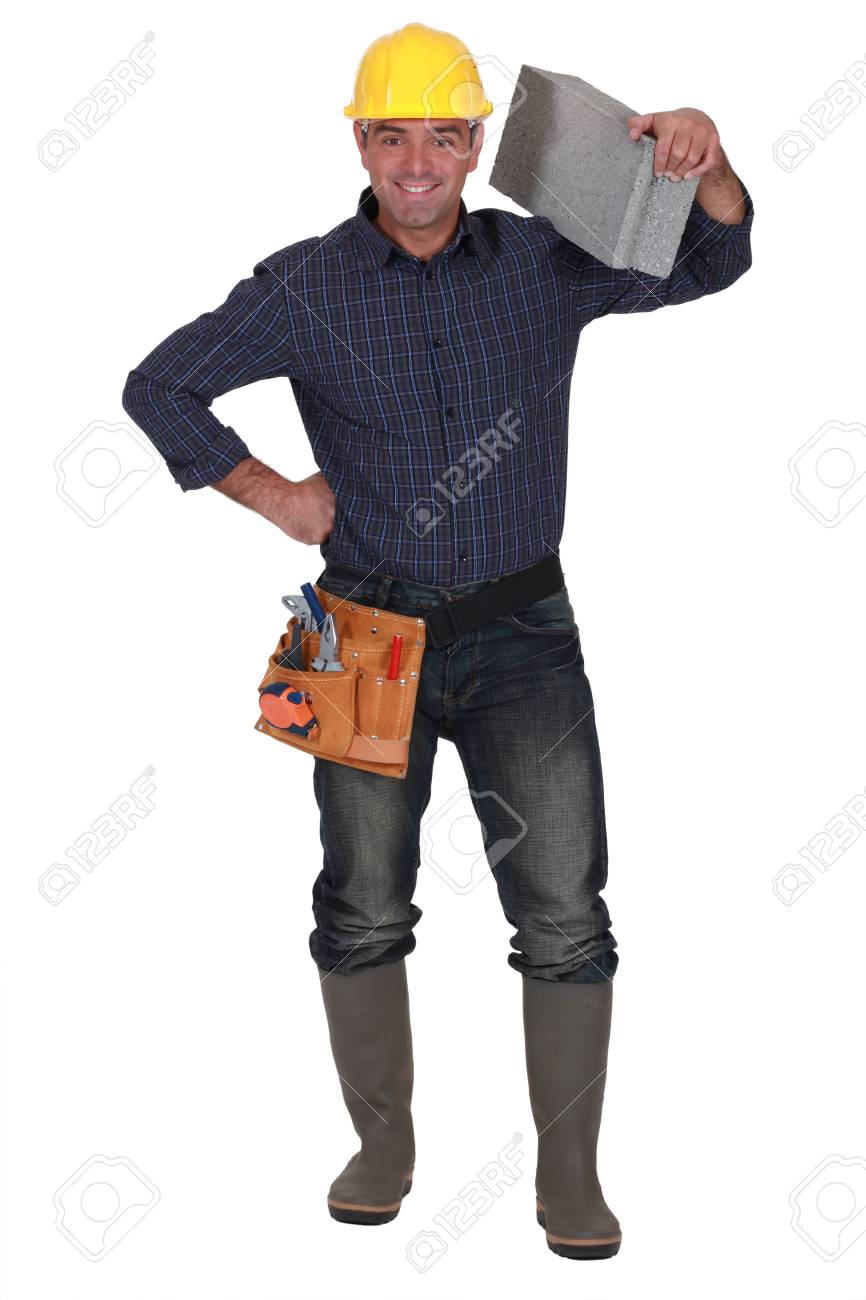 craftsman carrying a stone block on his shoulder Stock Photo - 13583445