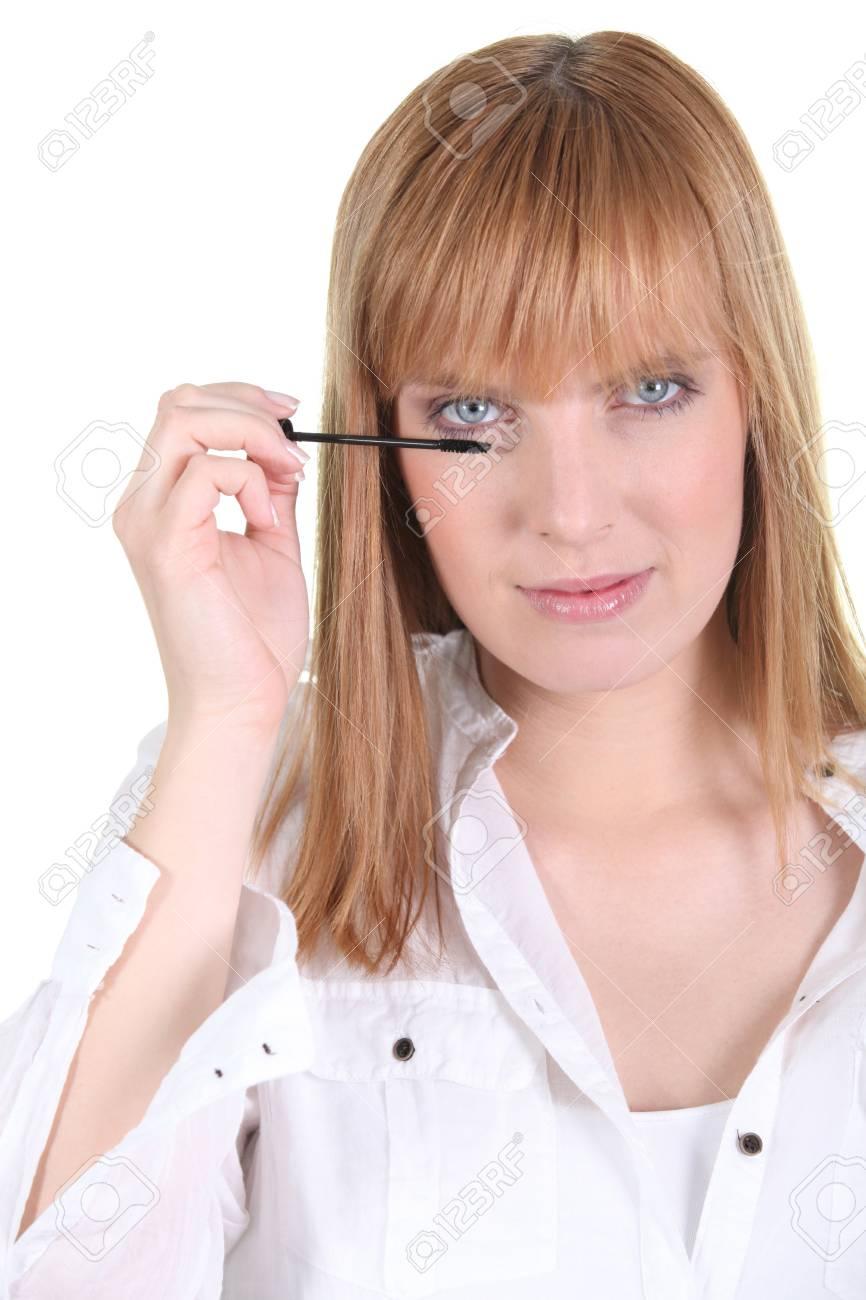 Woman applying mascara - 13582355