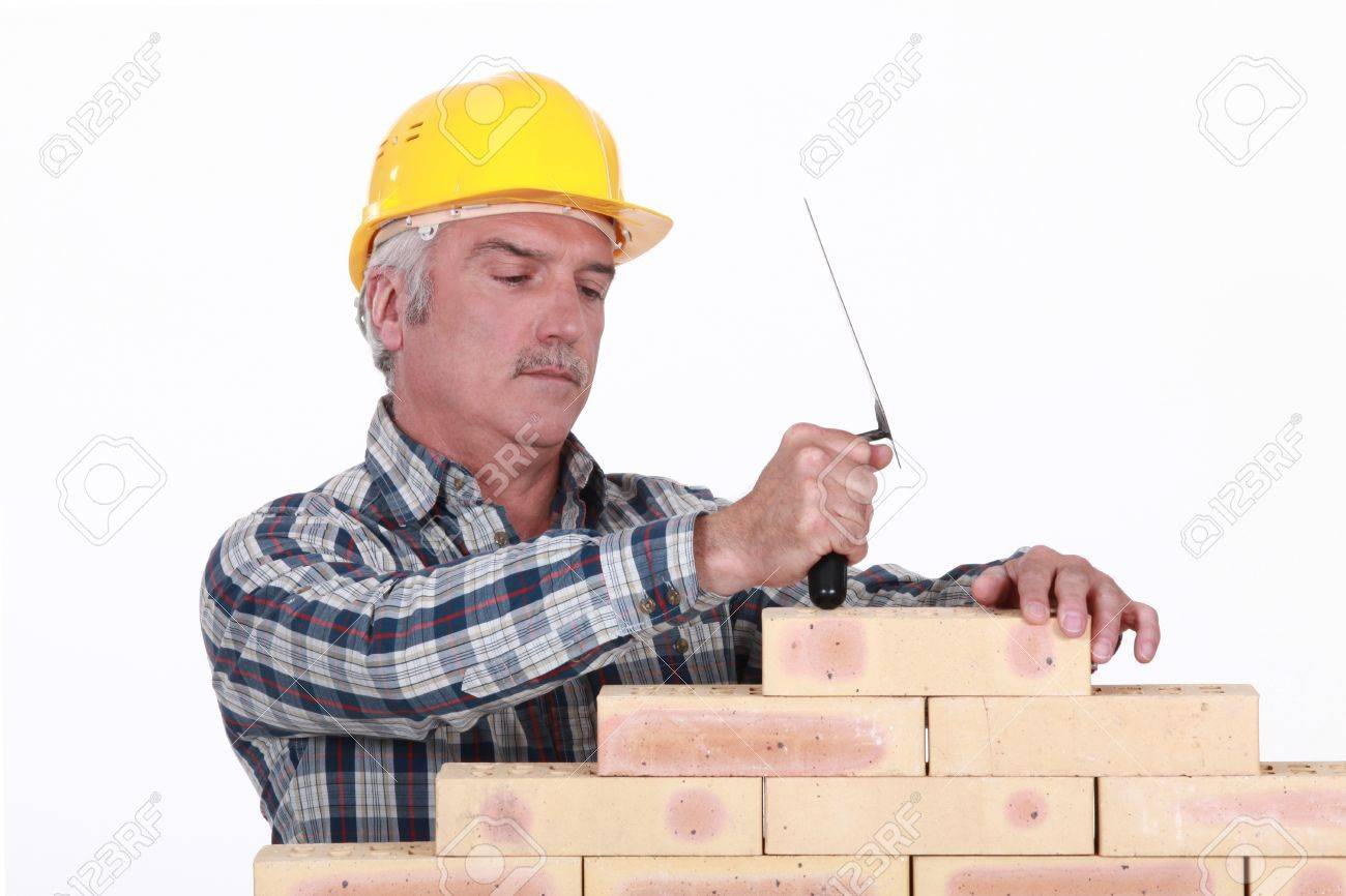 a mature mason building a wall stock photo, picture and royalty free
