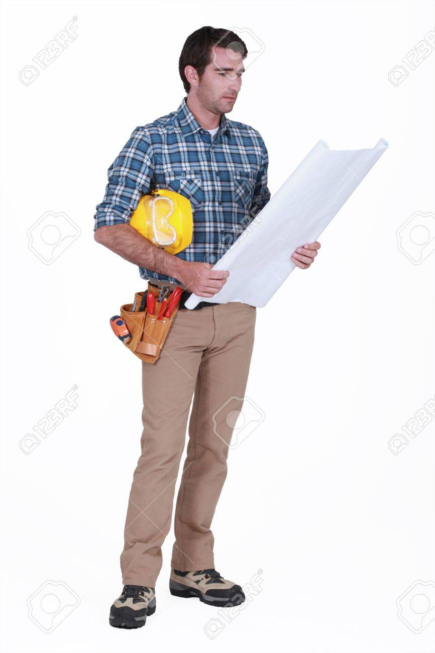 Construction foreman looking at a blueprint Stock Photo - 13645488