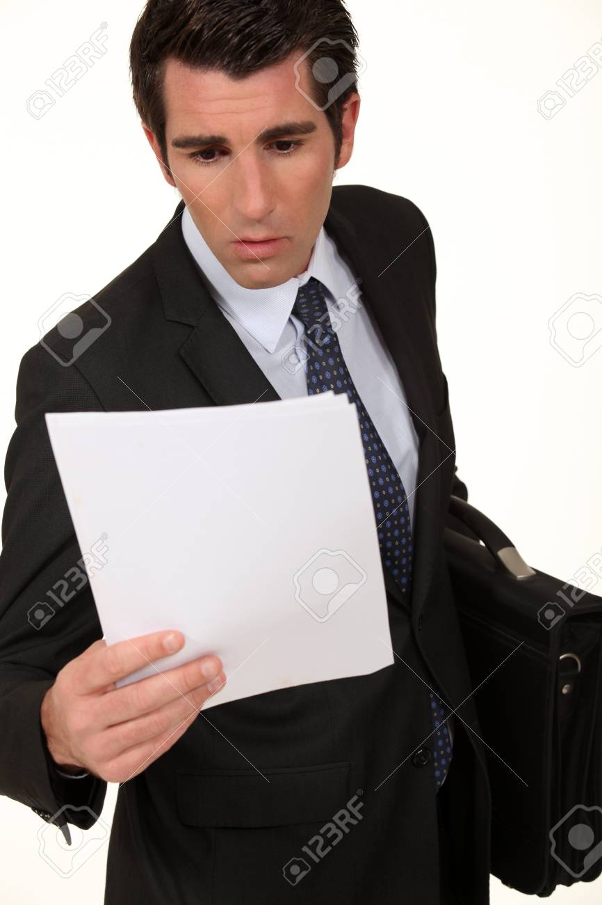 Shocked businessman reading document Stock Photo - 13645646