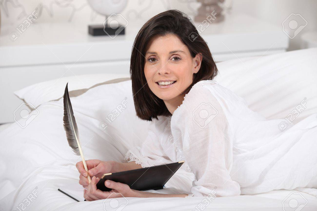 Brunette at home writing in diary Stock Photo - 13712375