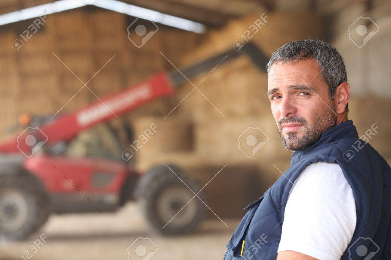farmer posing in front of a tractor Stock Photo - 13803321