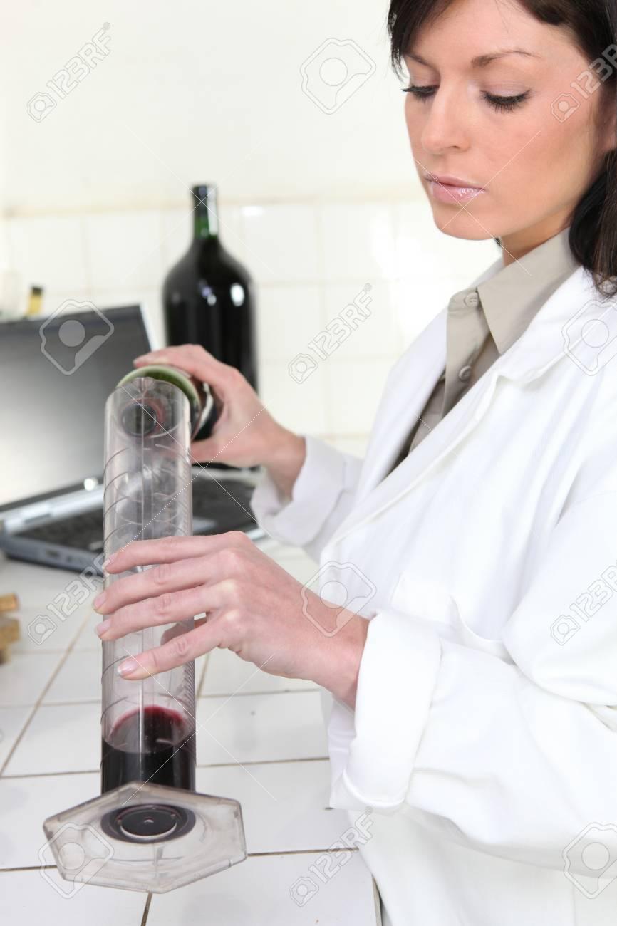 Oenologist analysing a wine Stock Photo - 13803440