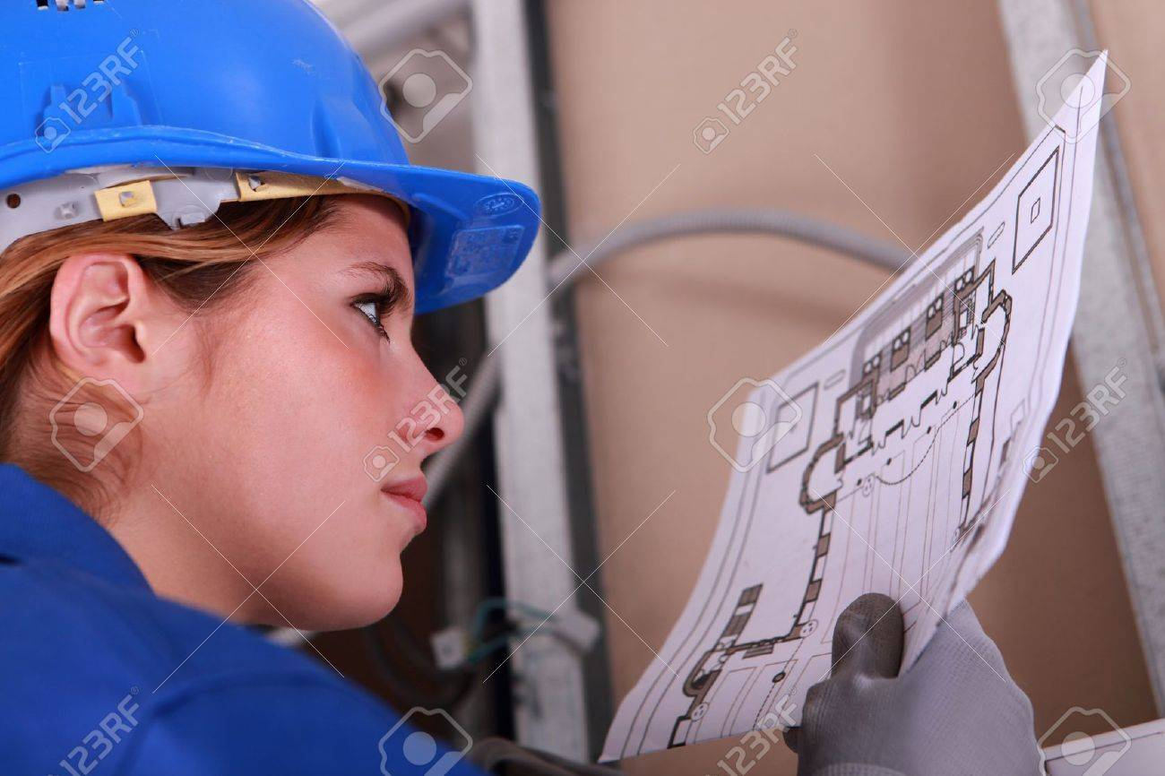 Female Electrician Reading Diagram Stock Photo Picture And Royalty 13782817