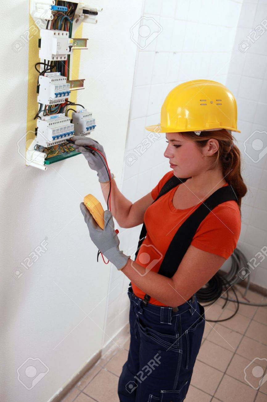 female electrician a fuse box stock photo picture and female electrician a fuse box stock photo 13783093