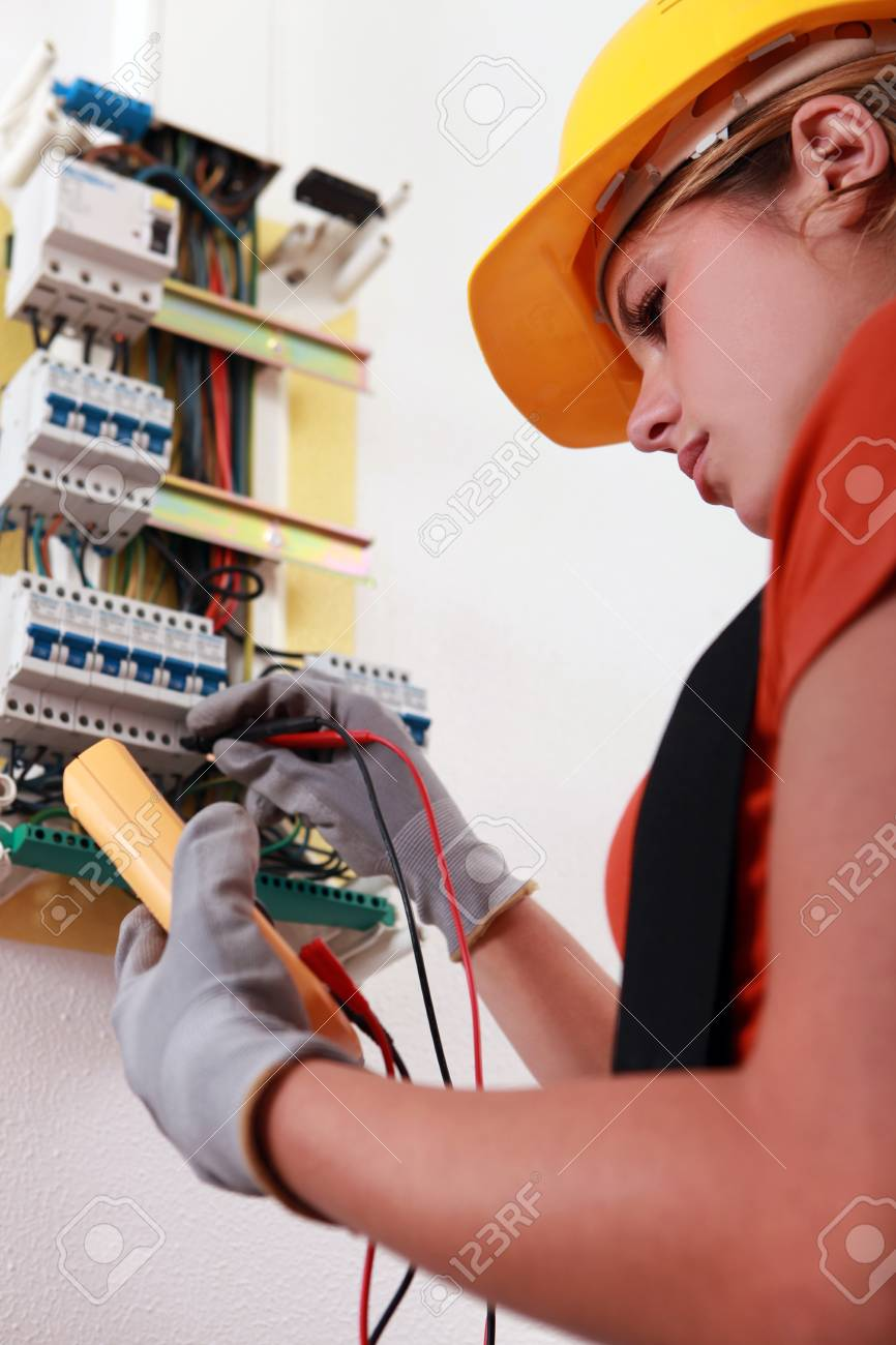 Woman with voltmeter - 13783057