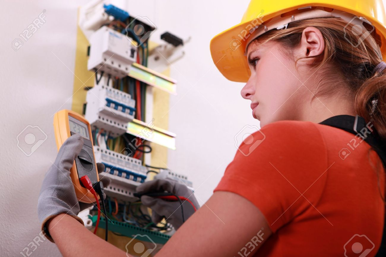 Woman measuring electrical current - 13783058