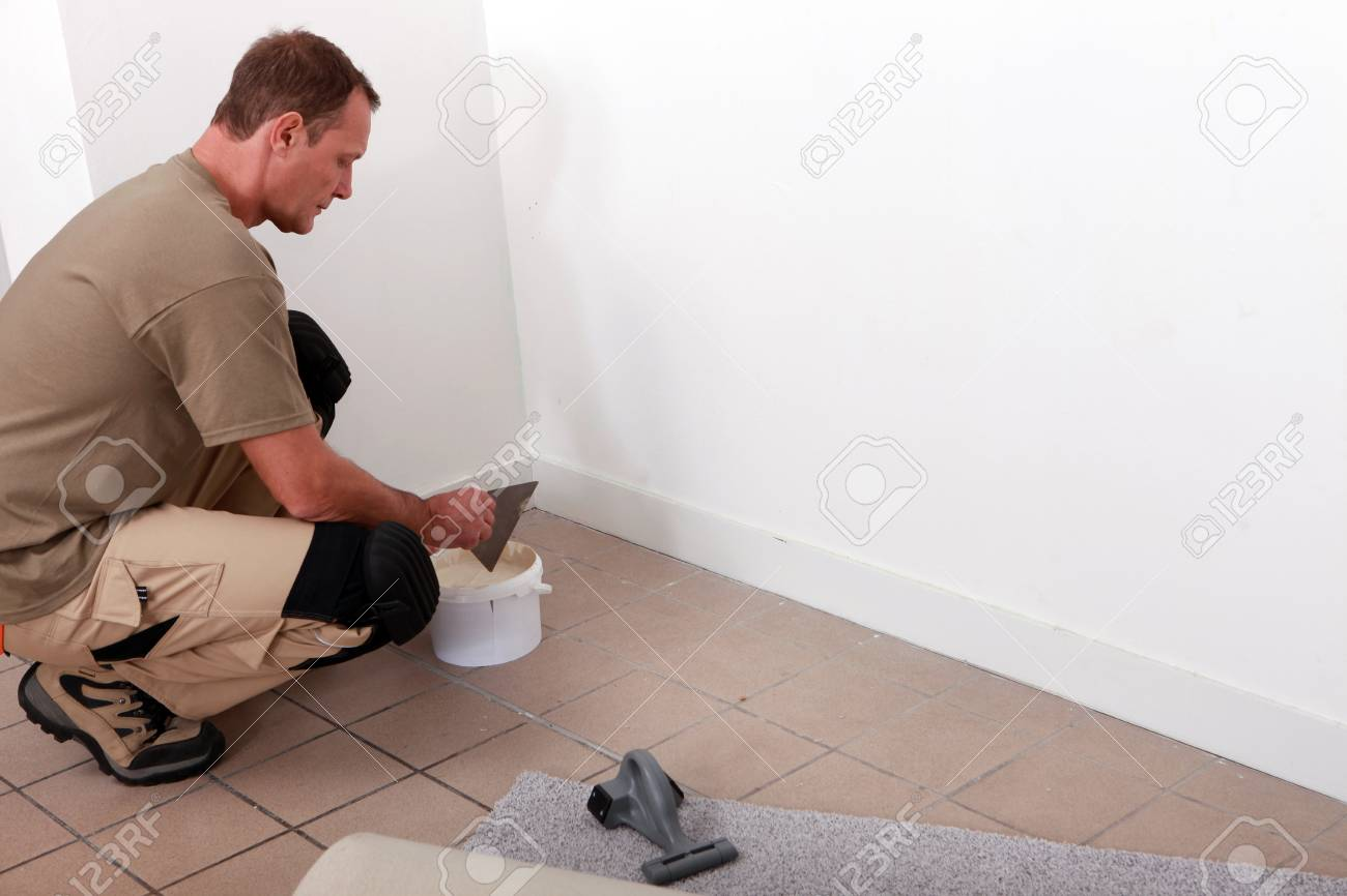 handyman laying fitted carpet Stock Photo - 13811828