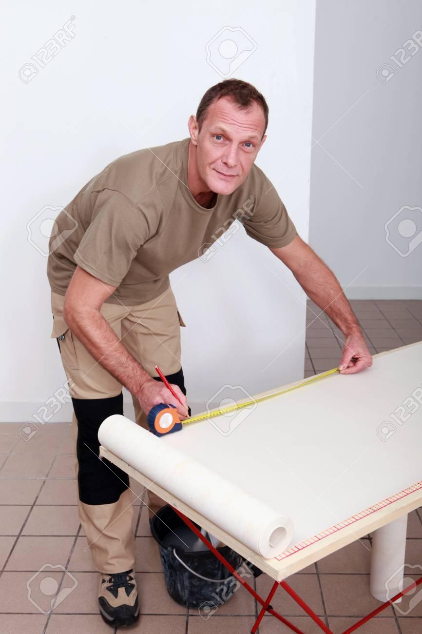 Man measuring wallpaper Stock Photo - 13810488