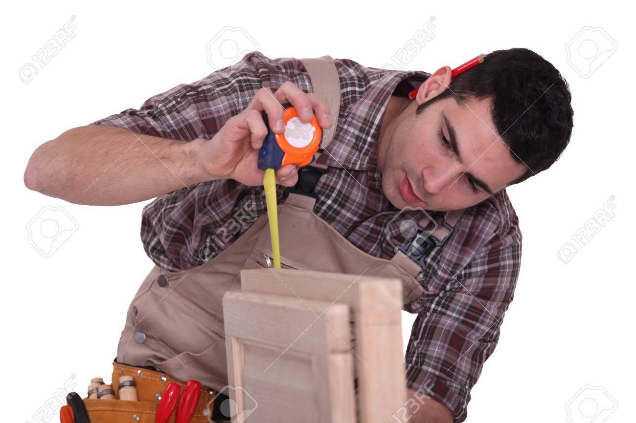 Cabinet maker measuring door Stock Photo - 13808390