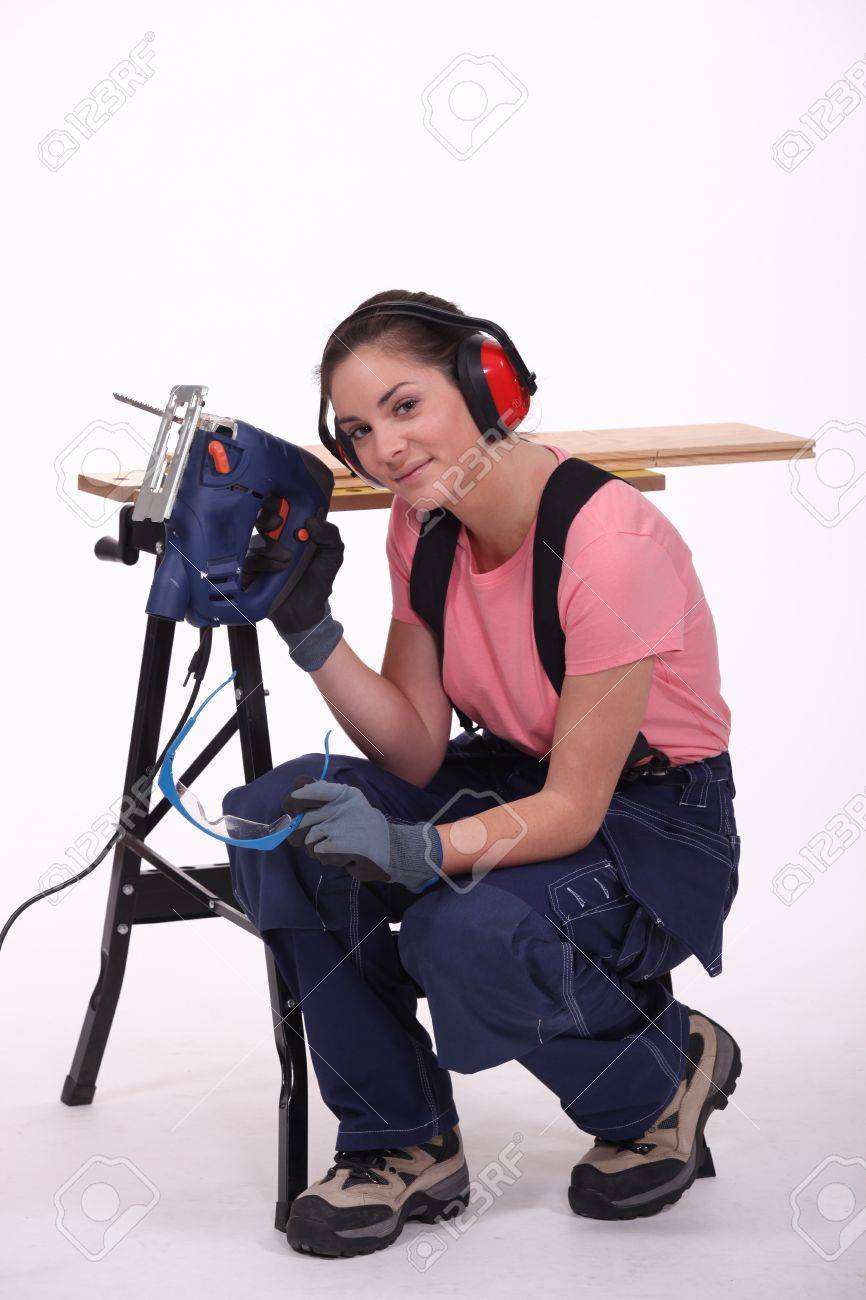 Woman with an electric saw Stock Photo - 13808400
