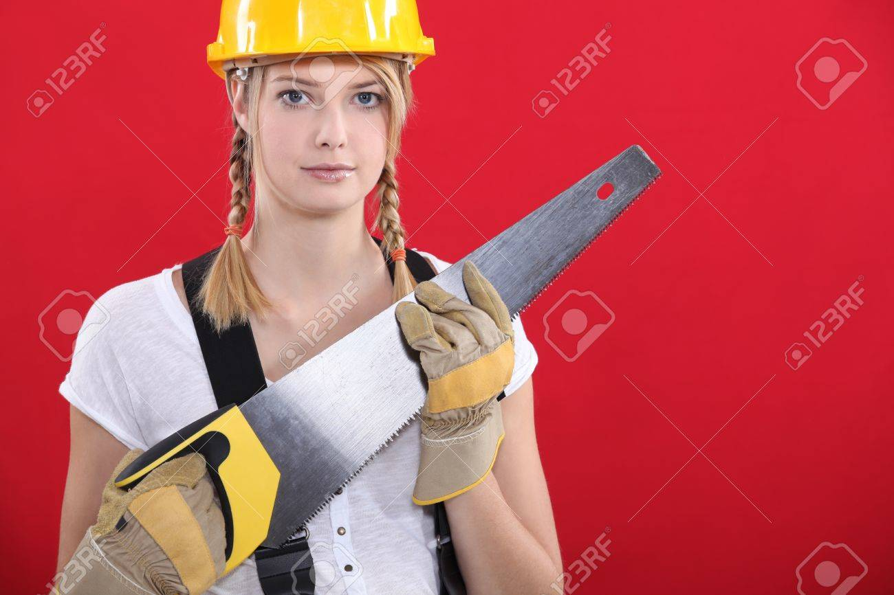 Woman with a saw Stock Photo - 13812049
