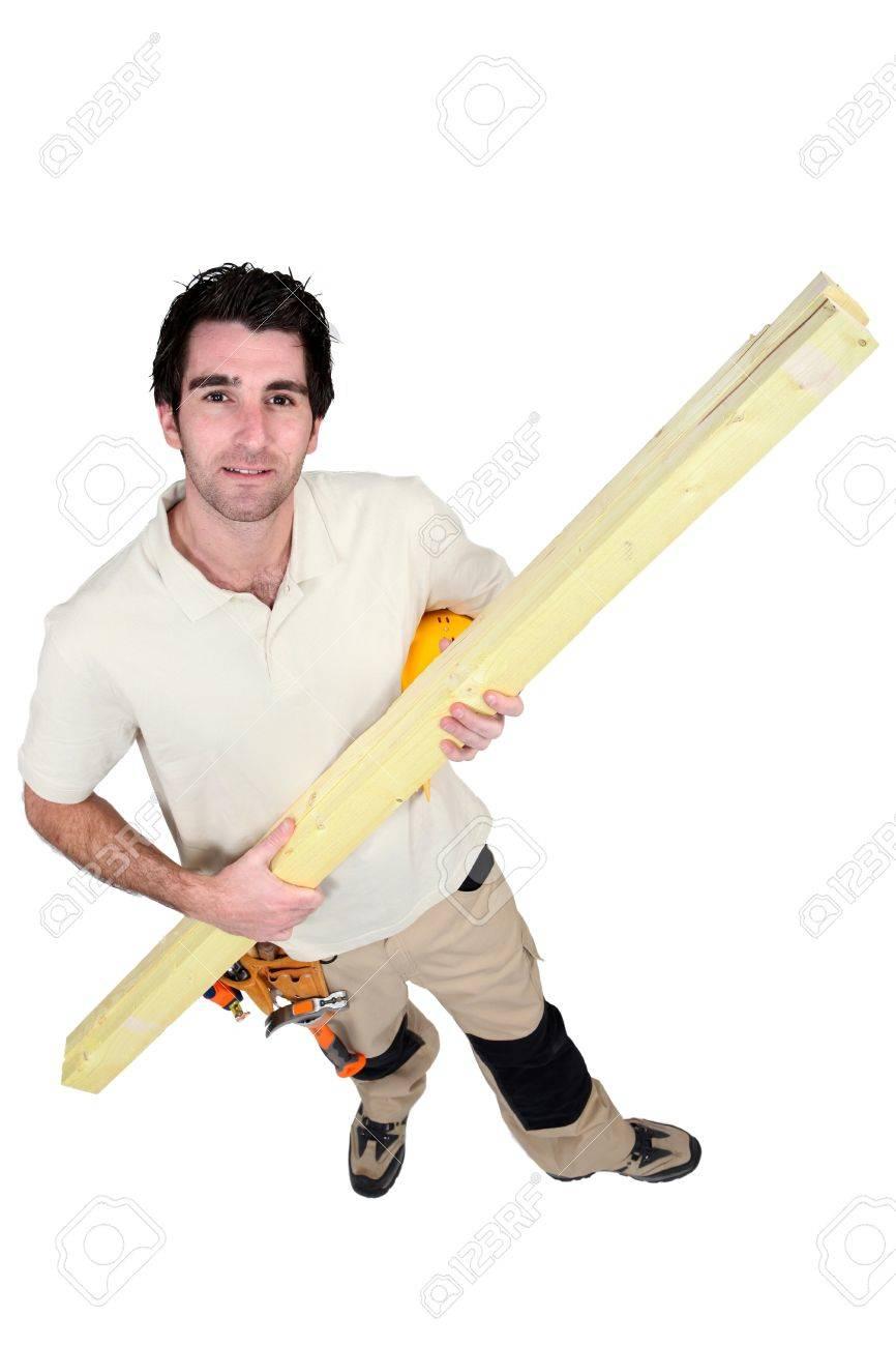 Man carrying timber Stock Photo - 13847736