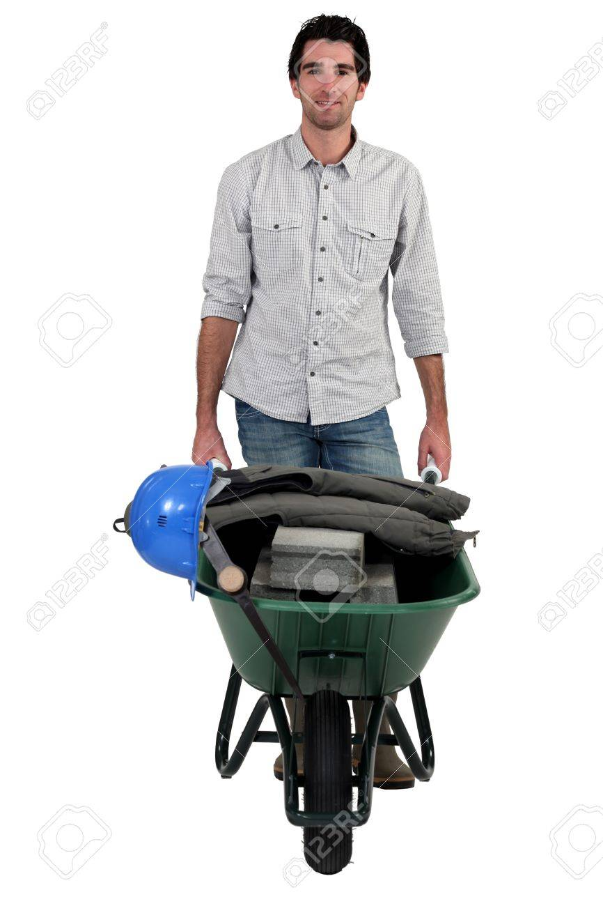 craftsman pushing a wheelbarrow Stock Photo - 13850806