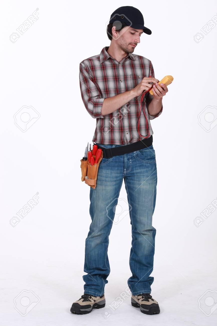 Man using voltmeter Stock Photo - 13884824