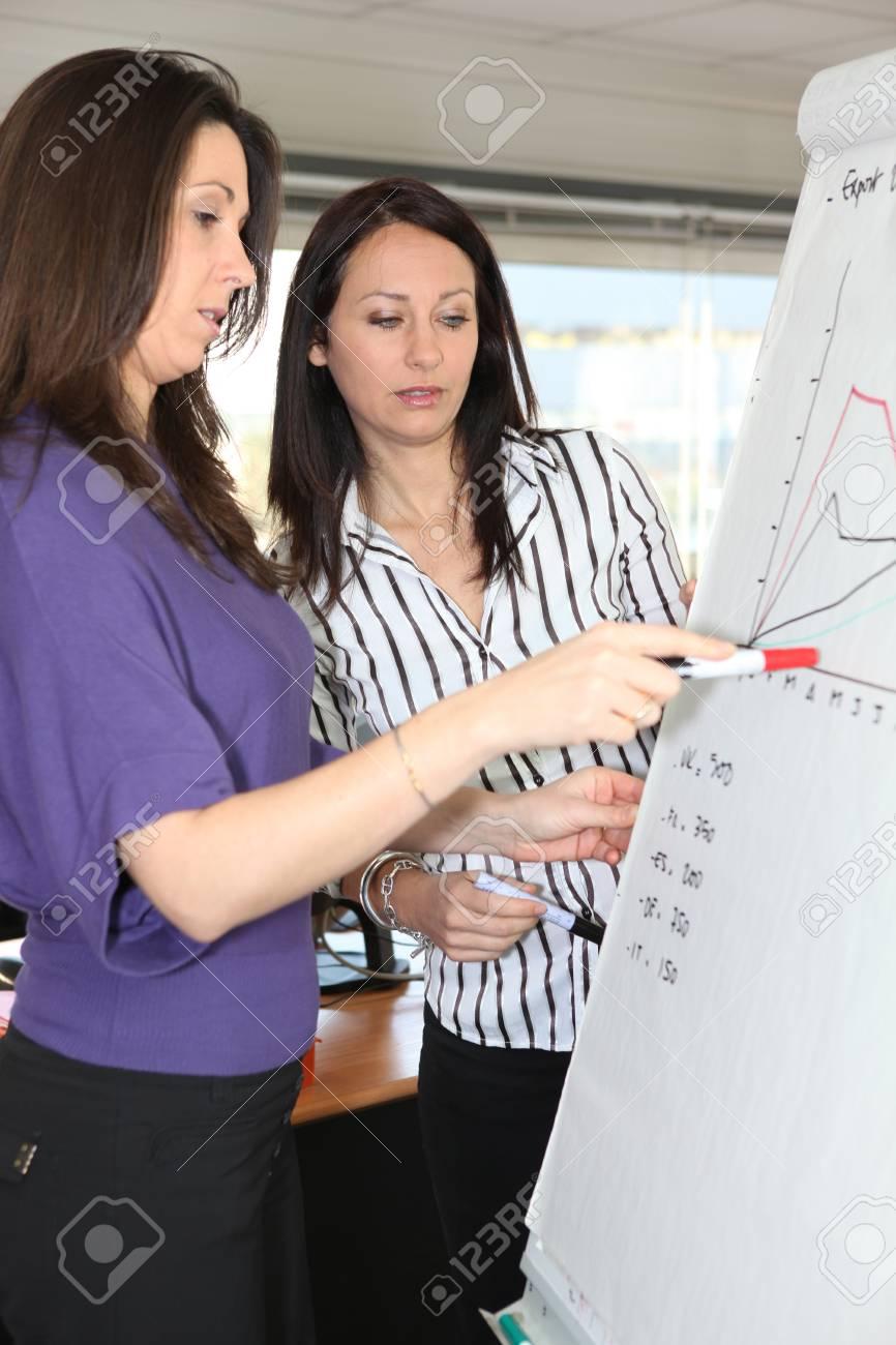 Woman explaining graph Stock Photo - 13886120