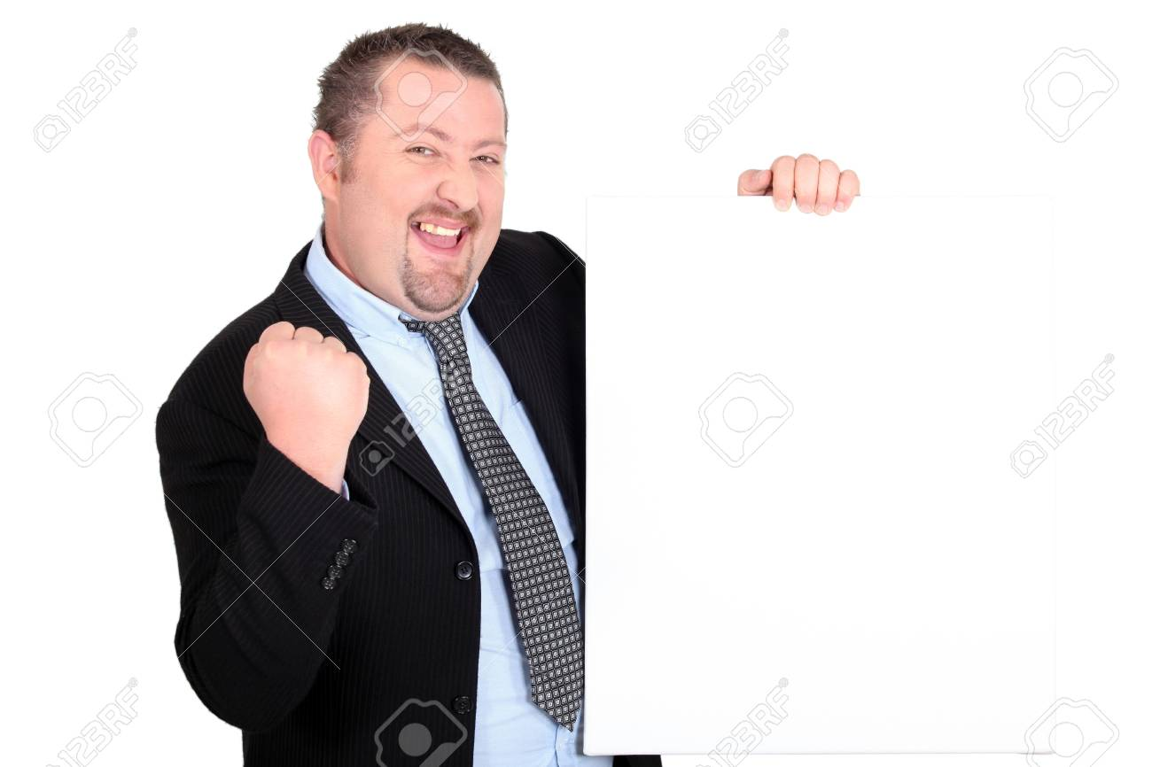 A successful businessman holding up a blank sign Stock Photo - 13851955