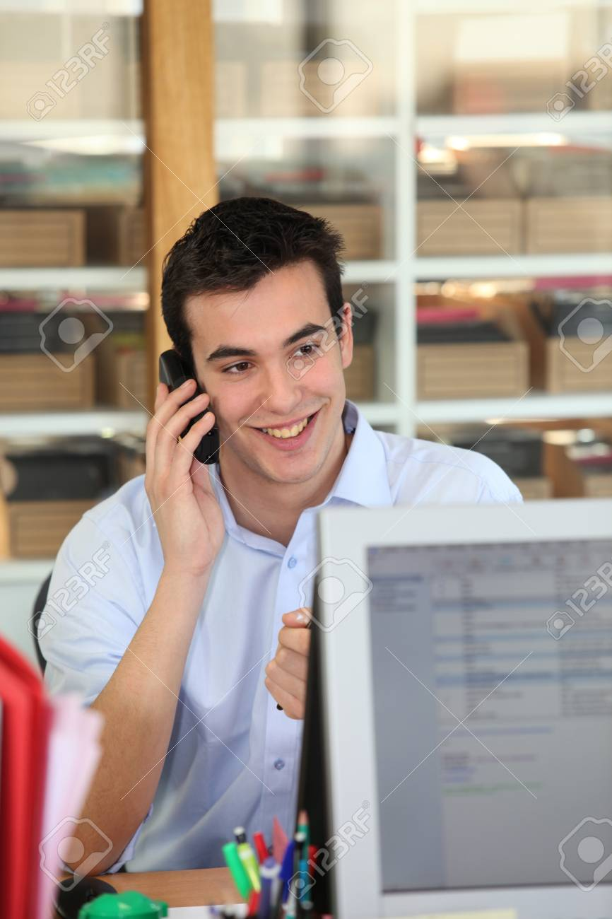 Male office worker speaking to customer on the telephone Stock Photo - 13883674