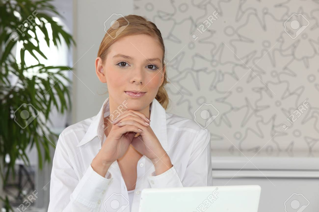 Pretty young woman with a laptop Stock Photo - 13898817