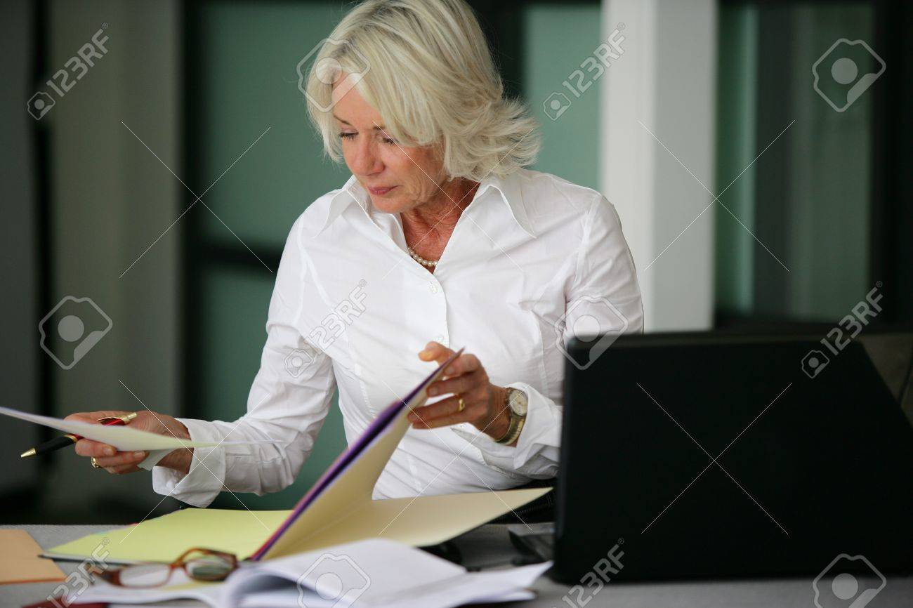 Woman looking through some files Stock Photo - 13852743