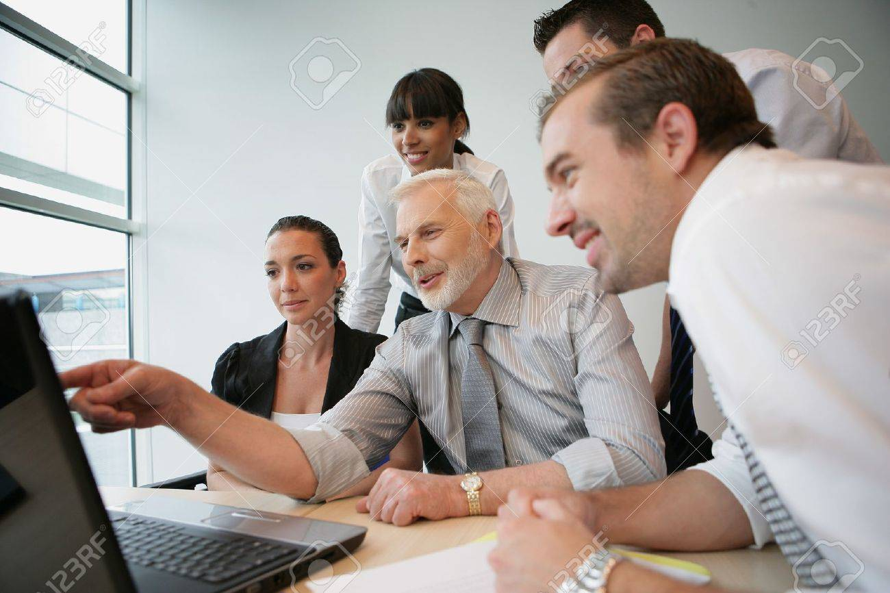 Salesteam in front of computer Stock Photo - 45586206