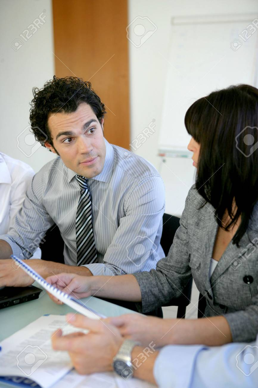 Worker explaining document to colleague Stock Photo - 13849034