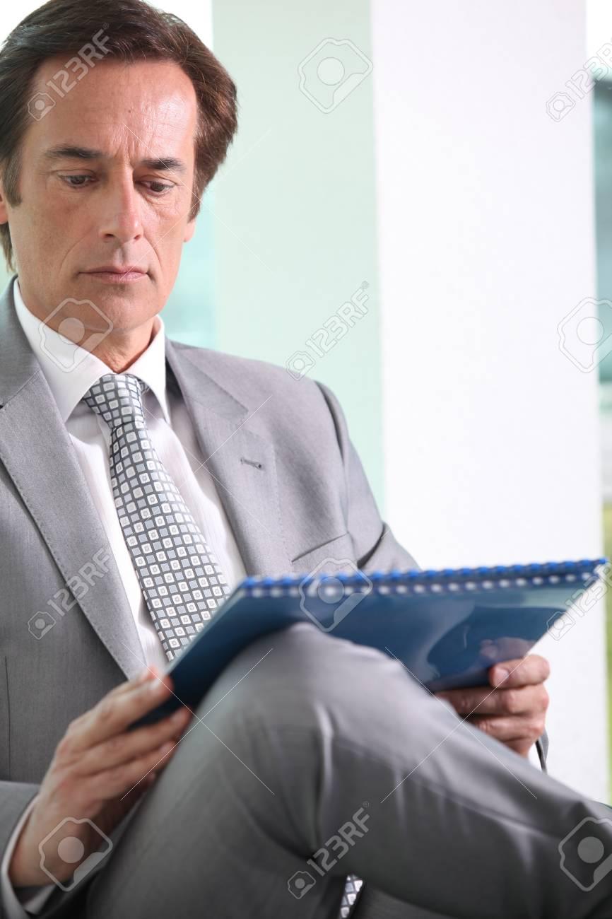 Businessman reading notes. Stock Photo - 13886108