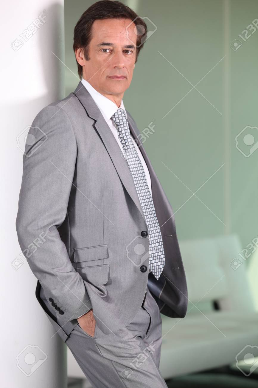 Businessman standing. Stock Photo - 13912358