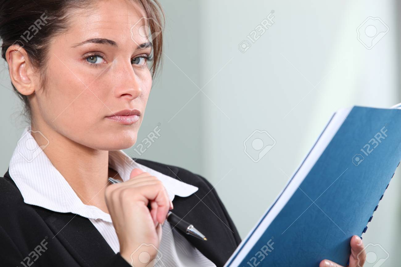 Serious young businesswoman making notes Stock Photo - 13884829