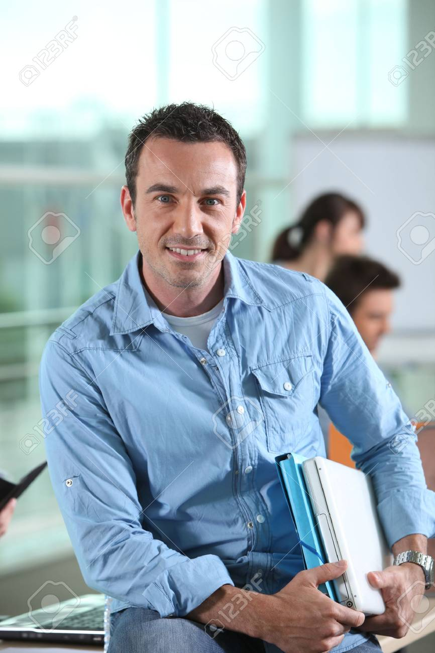 Lecturer sat near students Stock Photo - 13886024