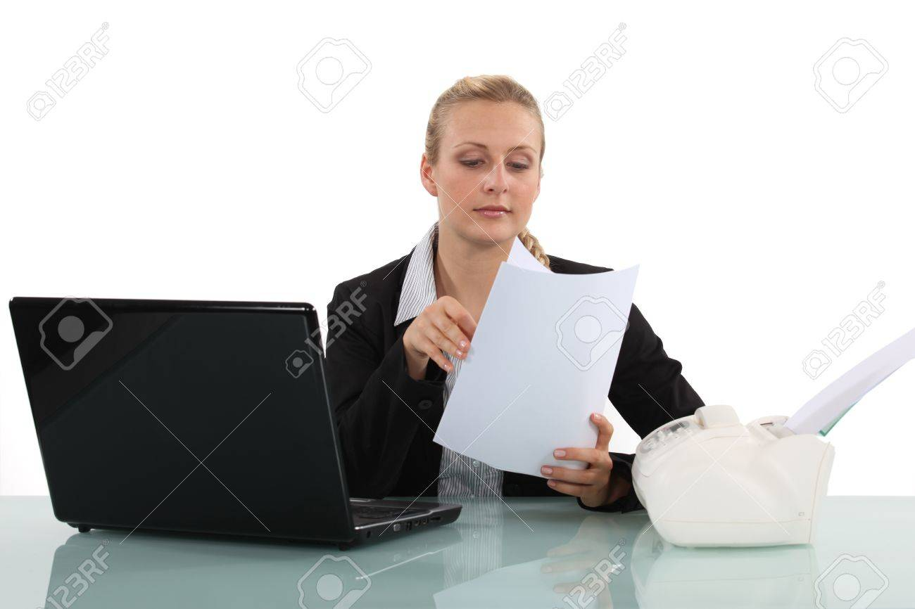 clerical worker flipping through a document stock photo picture