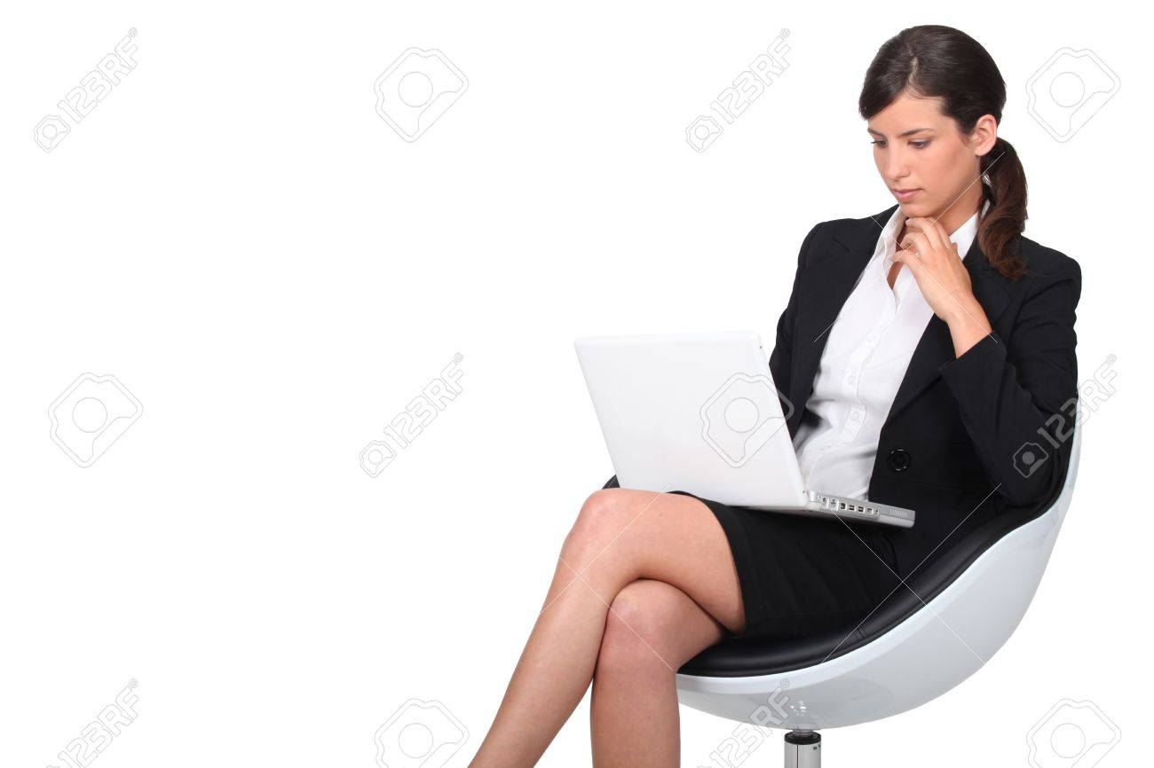 Woman sitting in armchair with computer Stock Photo - 13828445