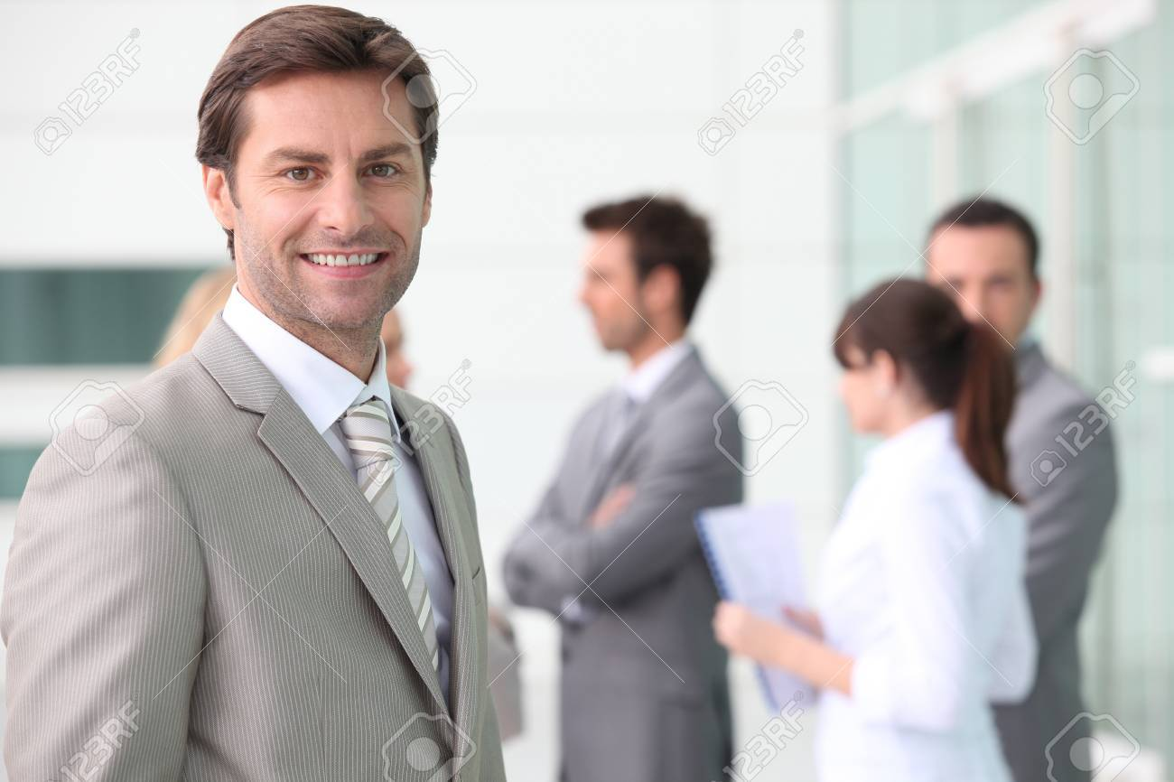 Smiling man with colleagues outside office building Stock Photo - 13846144