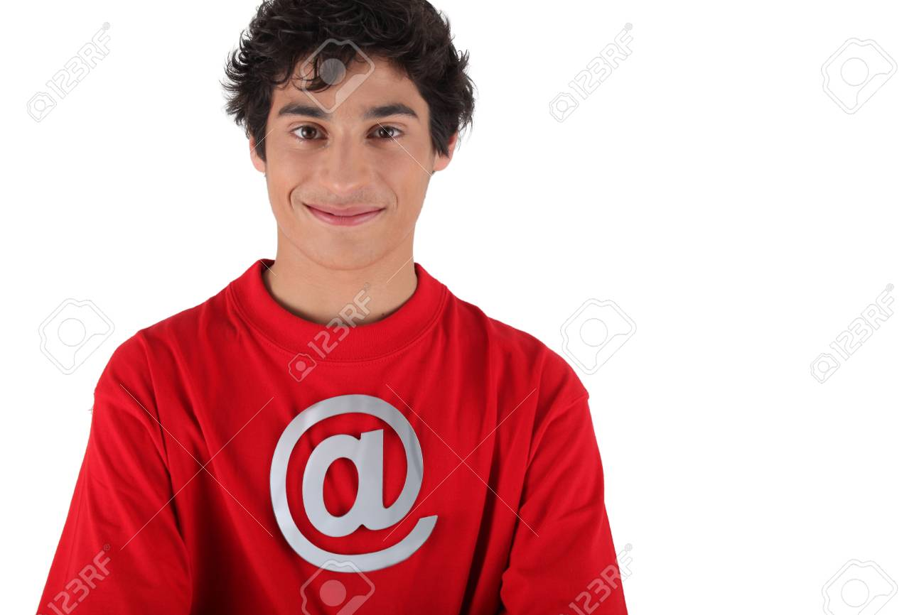 Smiling teenager with the at symbol on his t-shirt Stock Photo - 13839287