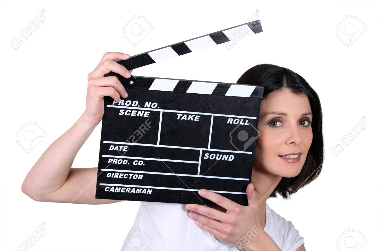 Woman with movie slate Stock Photo - 13848096