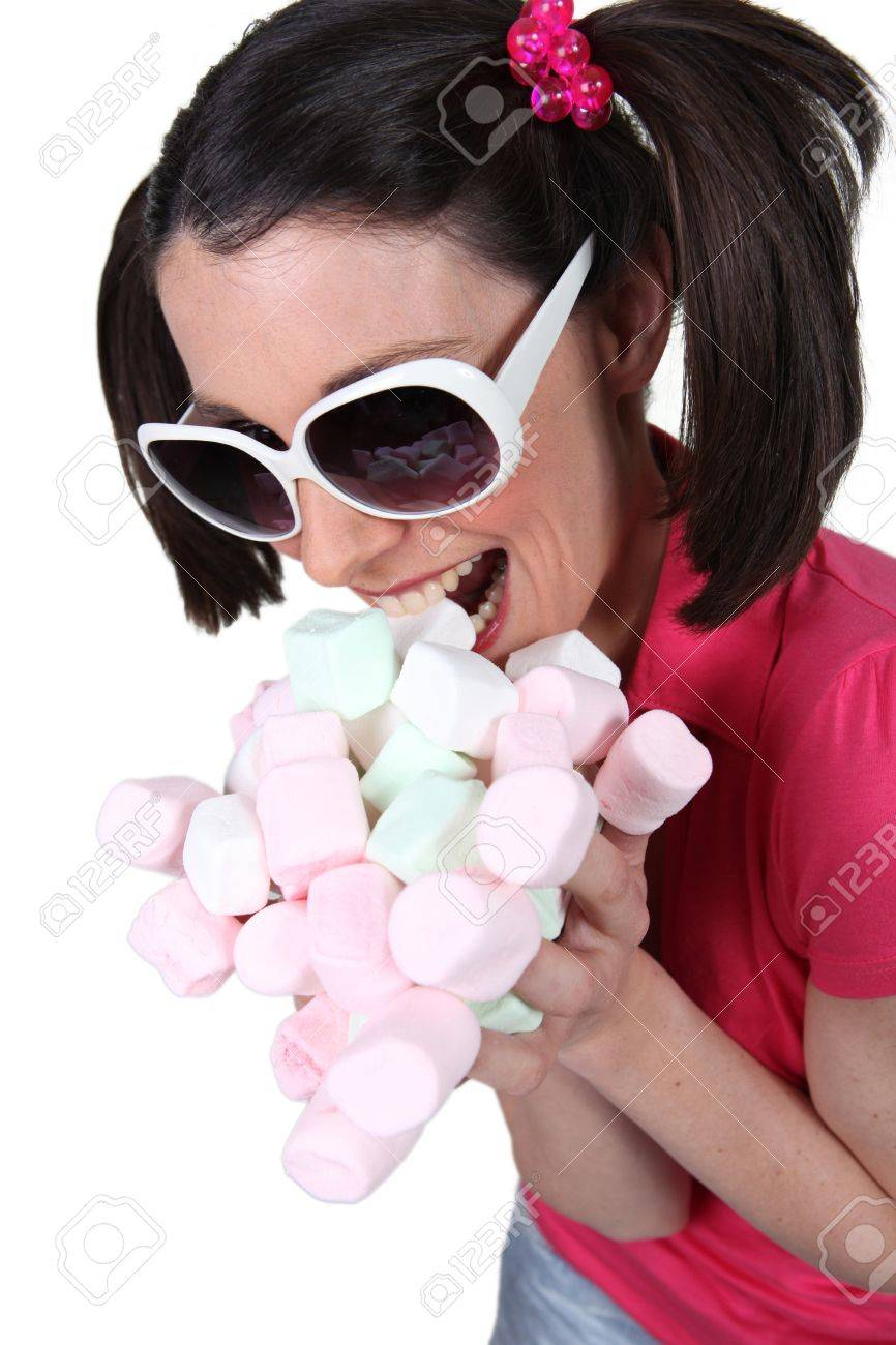 Woman scoffing marshmallows Stock Photo - 13848806