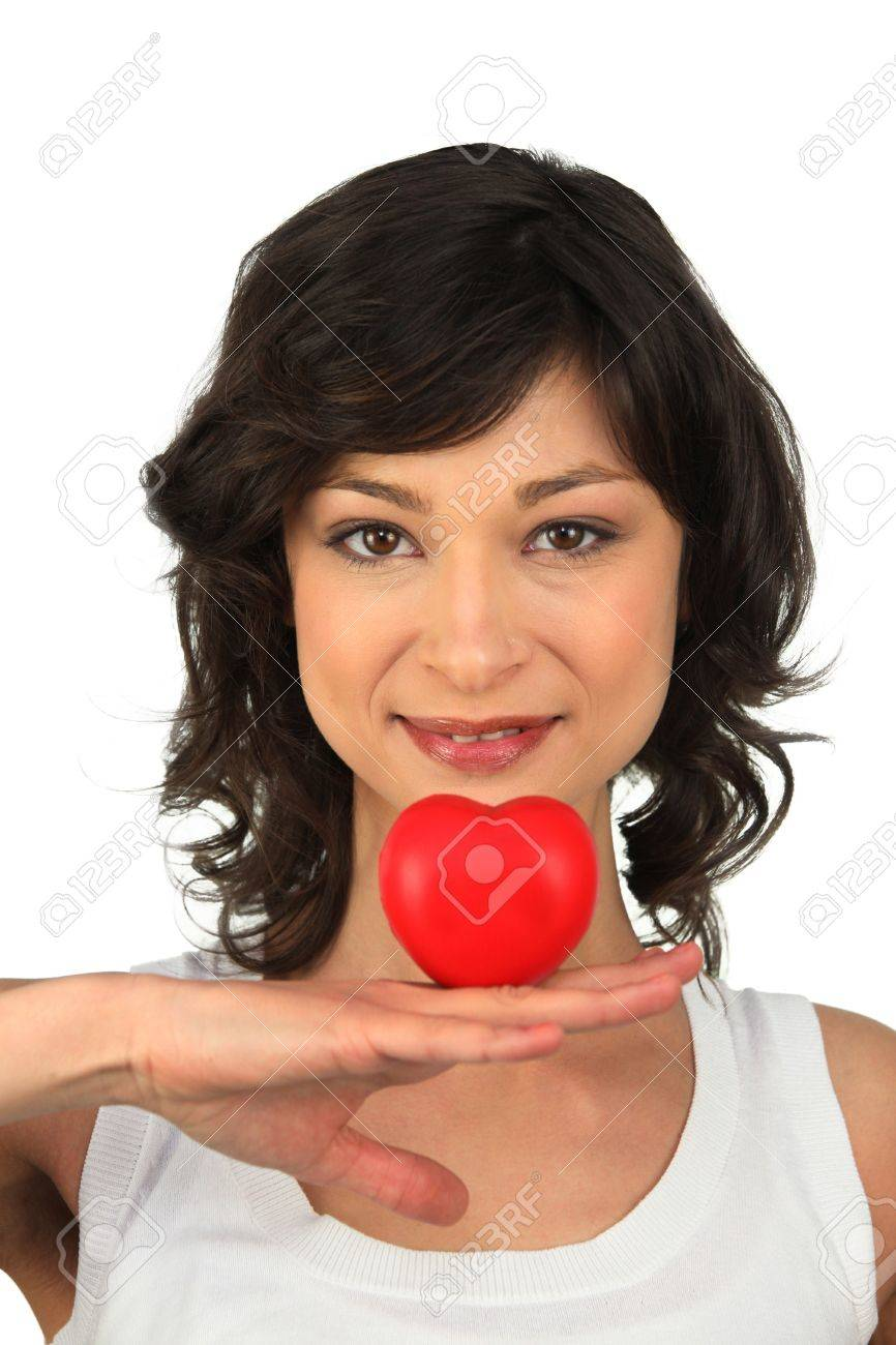 Brunette girl with heart in hand Stock Photo - 13849351