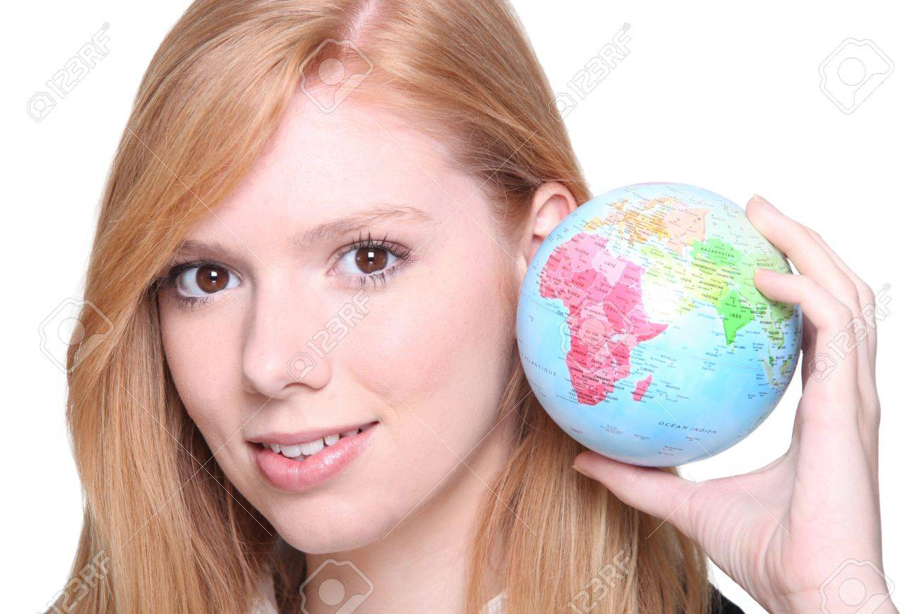 Ginger haired teen holding miniature globe Stock Photo - 13850328
