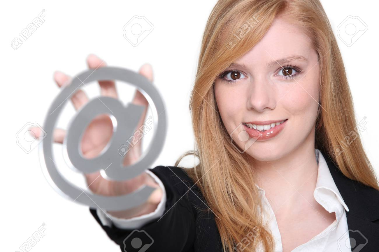 Young woman holding an @ sign Stock Photo - 13849392