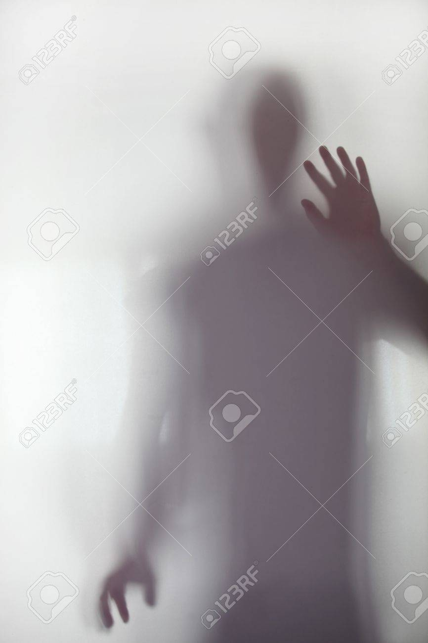 Person stood behind frosted glass Stock Photo - 13868180